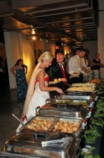 [Image: Give your guests a variety with a self-serving buffet at the reception. Everyone loves having a choice. A buffet is an excellent cost effective solution for feeding your wedding guests. ]